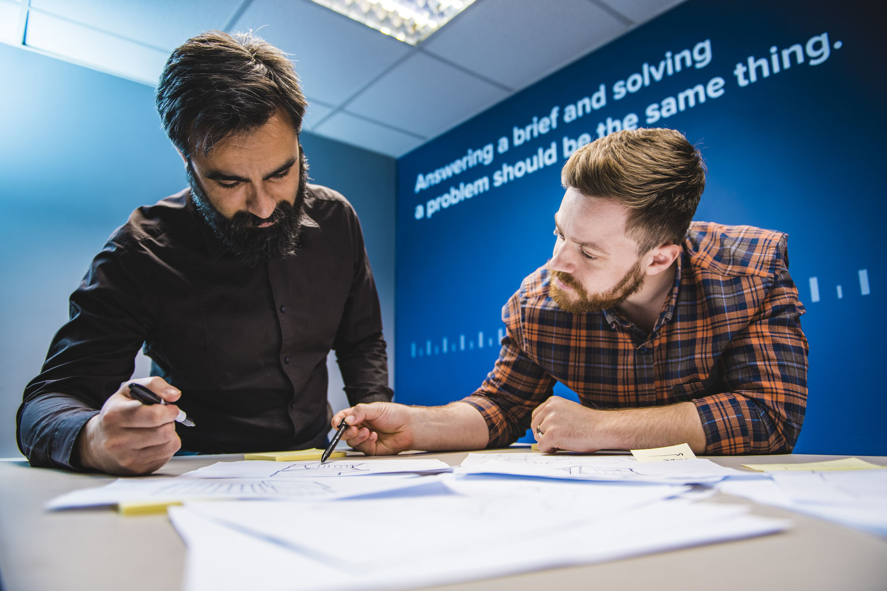 Designers working on retail display concept drawings